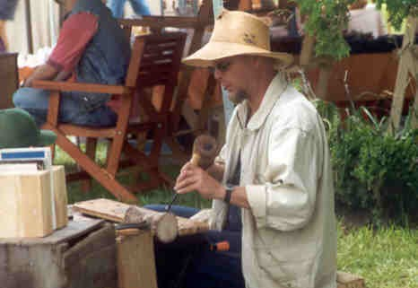 A                                       Floyd County artisan at work at an                                       outdoor craft show